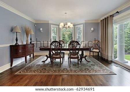Dining room in luxury home with picture window - stock photo