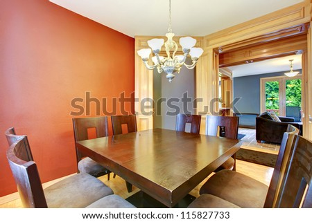 Dining room in red and blue and large wood table. - stock photo