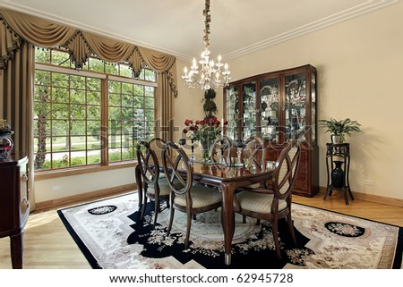 Dining room in suburban home with gold draperies - stock photo