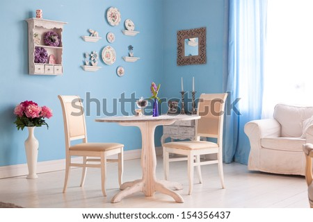 dining room interior with flowers decorative plates blue wall an - stock photo