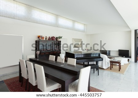 Dining room of a modern house, interior - stock photo