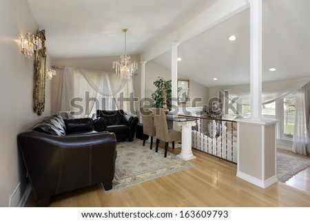 Dining room with columns above living room - stock photo