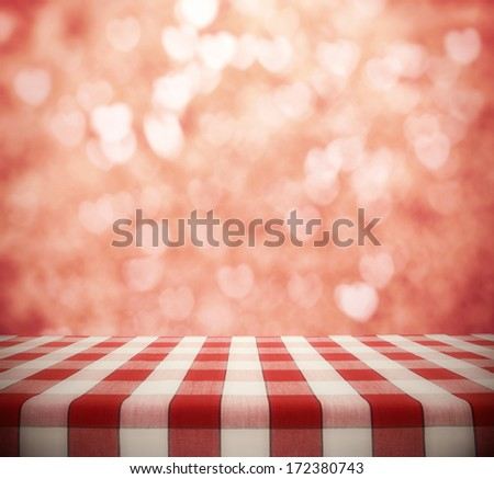 Dining Table on hearts bokeh background - stock photo