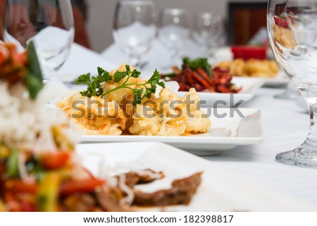 dining table set up with different kind of dishes - stock photo