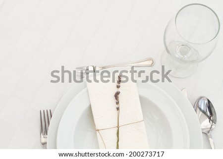 dining table setting with lavender - top view - stock photo