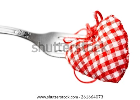Dinner. Macro studio image of stainless steel fork with red heart. Concept image for Valentine dinner/love food/love cooking etc. Differential focus with shallow DOF. Copy space. - stock photo