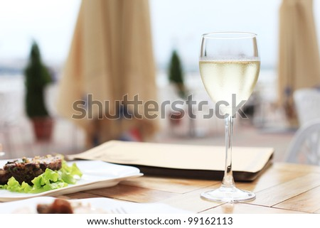 dinner on terrace in cafe - stock photo