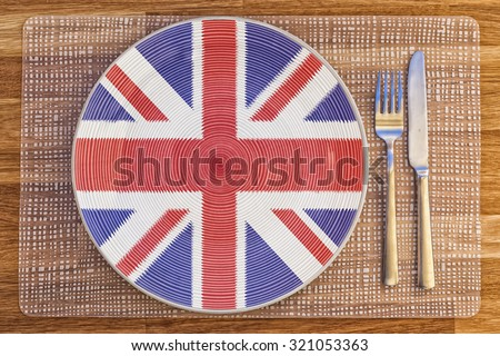 Dinner plate with the flag of Britain on it for your international food and drink concepts. - stock photo