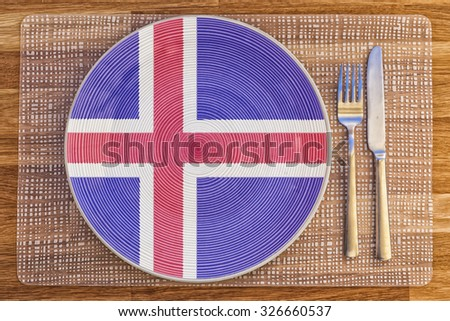 Dinner plate with the flag of Iceland on it for your international food and drink concepts. - stock photo