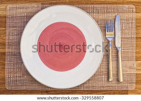 Dinner plate with the flag of Japan on it for your international food and drink concepts. - stock photo