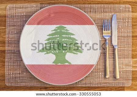 Dinner plate with the flag of Lebanon on it for your international food and drink concepts. - stock photo