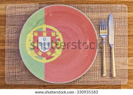 Dinner plate with the flag of Portugal on it for your international food and drink concepts. - stock photo