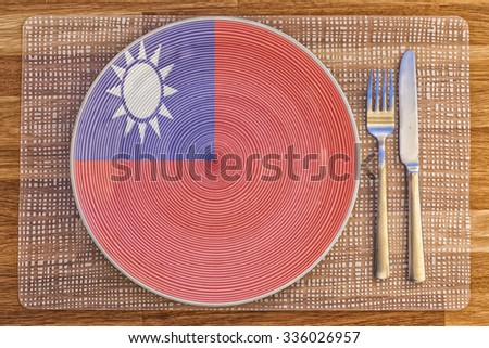 Dinner plate with the flag of Taiwan on it for your international food and drink concepts. - stock photo