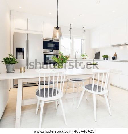 dinner table in fancy kitchen - stock photo