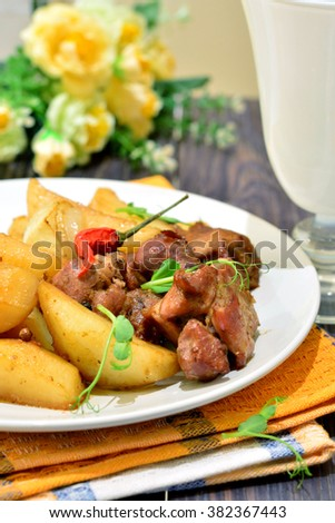 Dinner - turkey with potatoes on the plate - stock photo