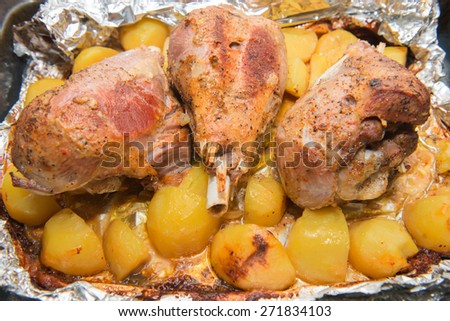 Dinner with baked in foil thigh turkey and potatoes - stock photo