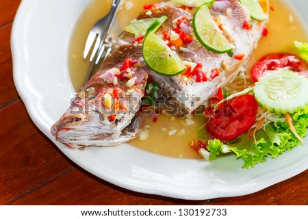 Dinner with freshly prepared Thai style whole red snapper fish - stock photo