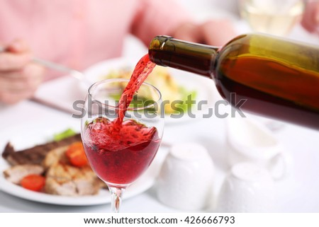 Dinner with wine in restaurant - stock photo
