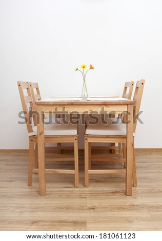 Dinning table and chairs  in empty  room. - stock photo