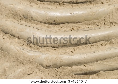 Dinosaur fossils in the sand - stock photo