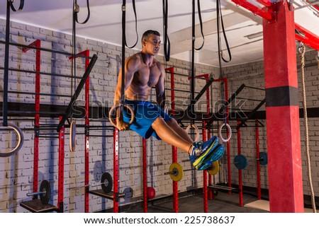 dip ring girl man muscle ups rings workout at gym - stock photo