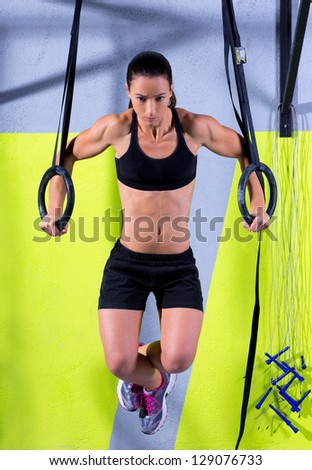 Dip ring woman workout at gym dipping exercise - stock photo