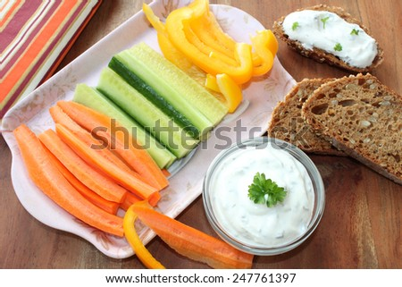 dip with vegetable sticks - stock photo