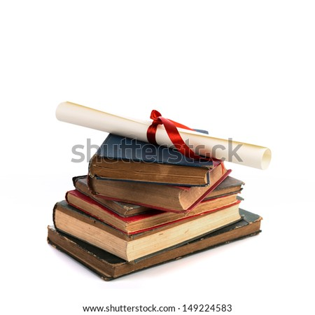 Diploma with old book isolated  on a white background. - stock photo
