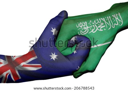 Diplomatic handshake between countries: flags of Australia and Saudi Arabia overprinted the two hands - stock photo