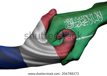 Diplomatic handshake between countries: flags of France and Saudi Arabia overprinted the two hands - stock photo
