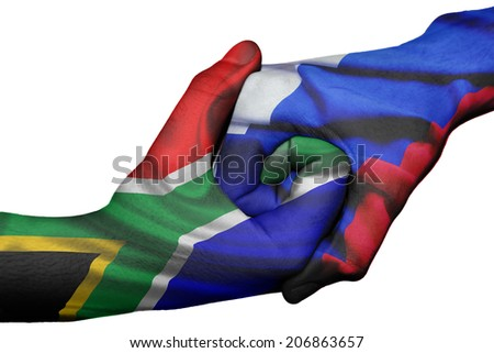 Diplomatic handshake between countries: flags of South Africa and Russia overprinted the two hands - stock photo