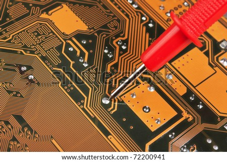 dipstick on the electronic board - stock photo