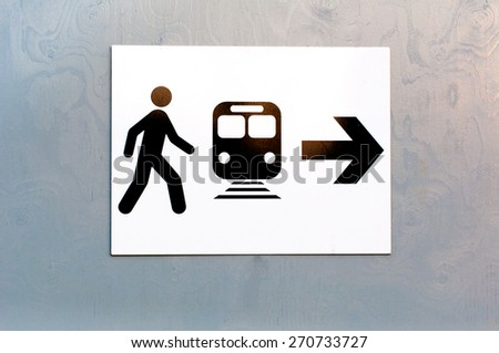 Direction for train station mounted on wooden background - stock photo