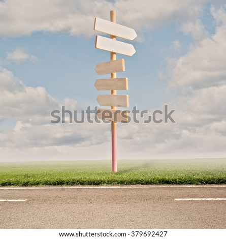 direction road signs on the road - stock photo