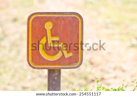 Direction sign for disabled in the park. - stock photo