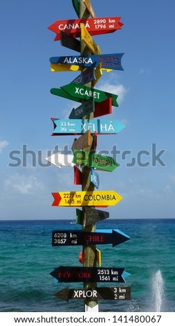 Direction sign in Xcaret near Playa del Carmen, Yucatan, Mexico - stock photo
