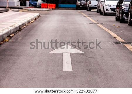 Directional arrow pointing forward street. - stock photo