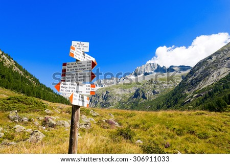Directional Trail Signs in Mountain - Italian Alps / Typical directional trail signs in mountain in the National Park of Adamello Brenta. Trentino Alto Adige, Italy - stock photo