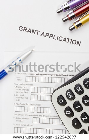 Directly above photograph of a grant application. - stock photo