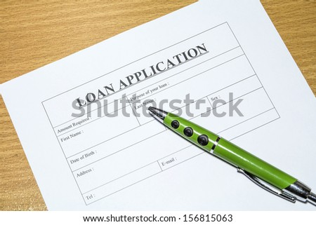 Directly above photograph of a loan application. - stock photo