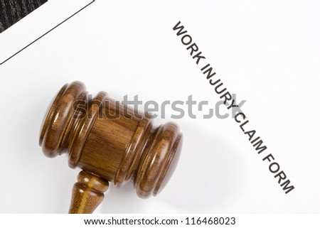 Directly above photograph of a work injury claim form. - stock photo