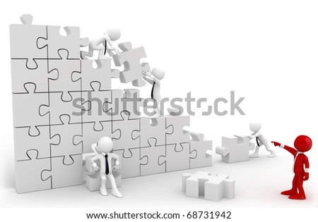 Director and employees working together to put the pieces of a puzzle - stock photo