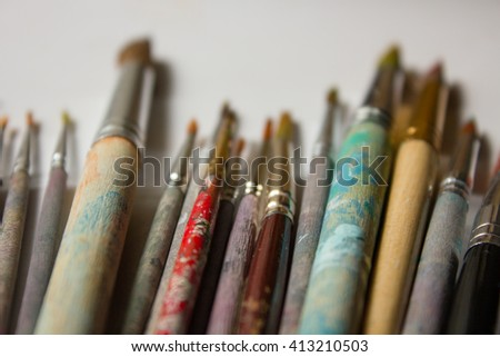 Dirt paint brush to paint lie in the sun - stock photo