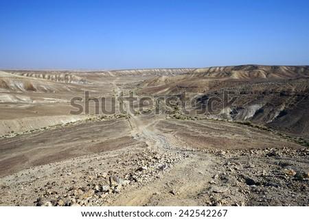 Dirt road and mountsain in Negv desert, Israel                                 - stock photo