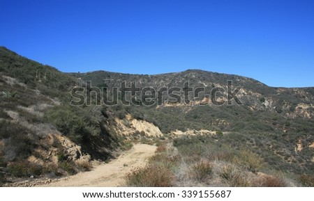 Dirt road in the mountains, Angeles National Forest, CA - stock photo