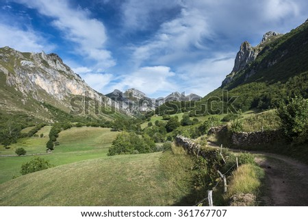 Dirt road in Valle del Lago, one of fifteen parishes in Somiedo, a municipality located in the central area of the Cantabrian Mountains, Principality of Asturias, Spain - stock photo