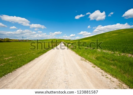 Dirt Road Leading To the Farmer's House in Tuscany - stock photo