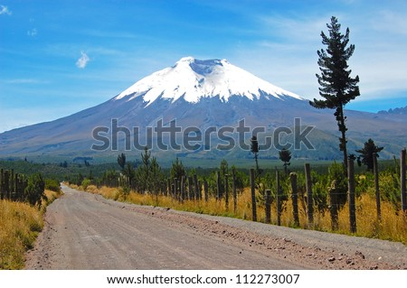 Dirt road that leads to the majestic Cotopaxi (the highest active volcano in the world), in the heart of the Andes, Ecuador, South America. - stock photo
