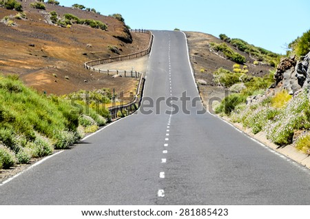 Dirt Road through the Desert in Tenerife Island Spain - stock photo