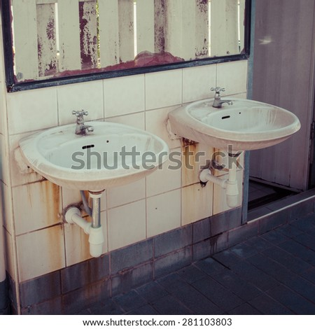 Dirty basin in public toilets, process color - stock photo